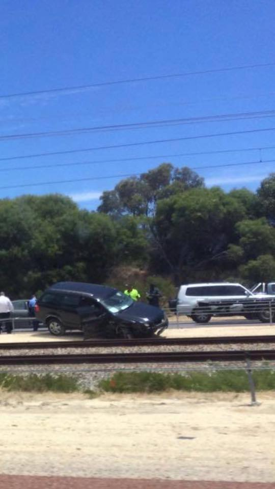 A black car crashed near a rail track and towed by Allout's towing service