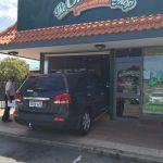 A Kia car shown crashed into a cheese cake shop