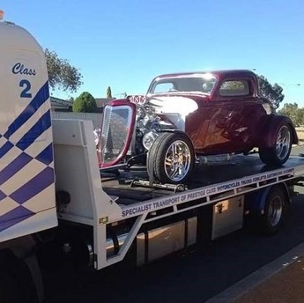 Vintage Hotrod transported by Allout Towing