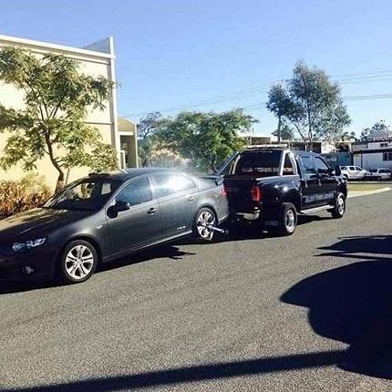 Black Sedan towed