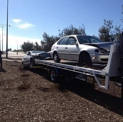 Allout Towing towing a crashed silver car